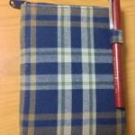 無印のブックカバーを装着したHobonichi Plannnerと筆ペン